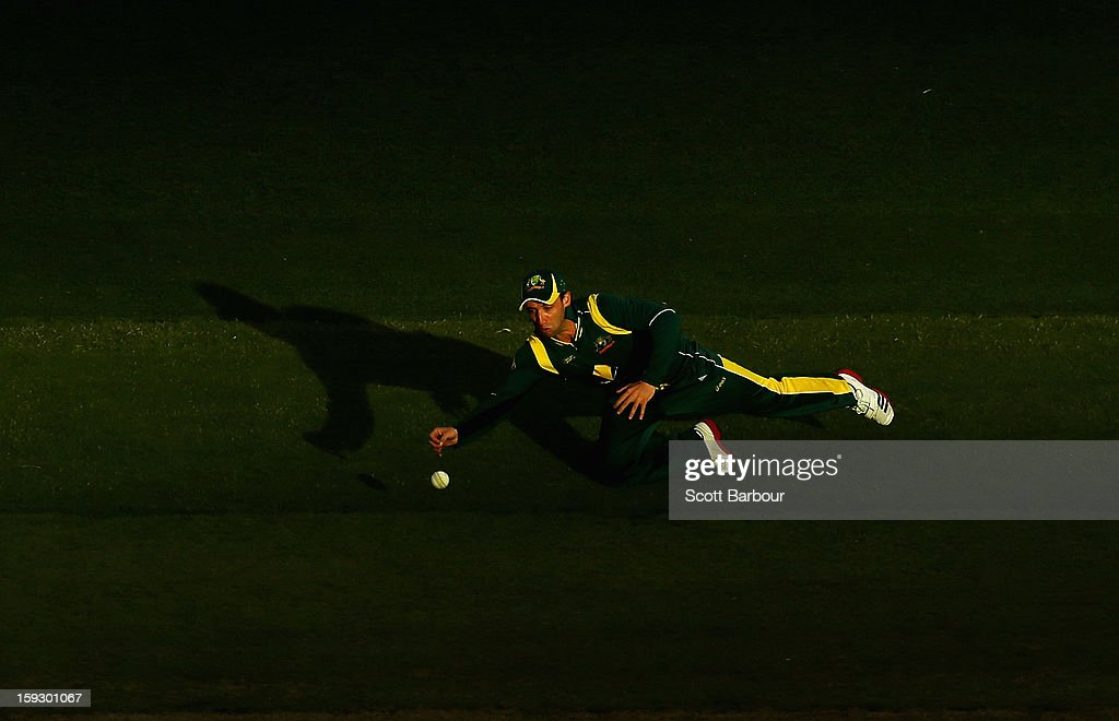 Phillip Hughes of Australia dives to stop the ball during game one of the Commonwealth Bank One Day International series between Australia and Sri Lanka at Melbourne Cricket Ground on January 11, 2013 in Melbourne, Australia.