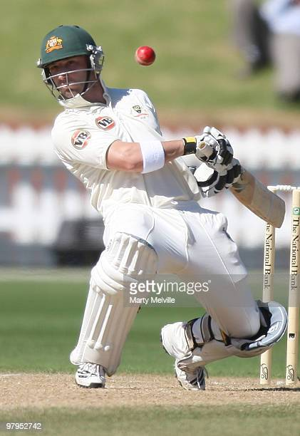 Phillip Hughes of Australia dodges a bouncer during day five of the First Test match between New Zealand and Australia at Westpac Stadium on March 23...