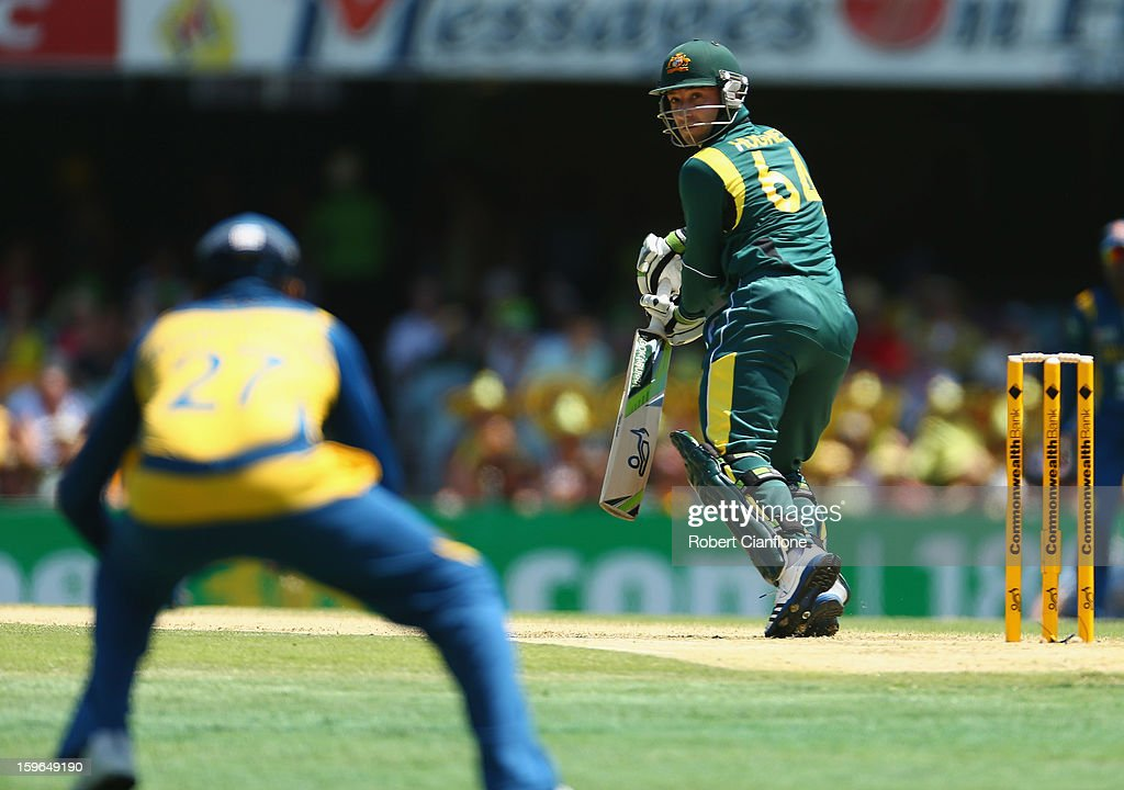 Phillip Hughes of Australia edges the ball to Mahela Jayawardene of Sri Lanka during game three of the Commonwealth Bank One Day International Series between Australia and Sri Lanka at The Gabba on January 18, 2013 in Brisbane, Australia.