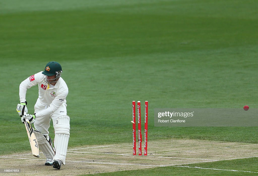 <a gi-track='captionPersonalityLinkClicked' href=/galleries/search?phrase=Phillip+Hughes+-+Cricketer&family=editorial&specificpeople=757530 ng-click='$event.stopPropagation()'>Phillip Hughes</a> of Australia is bowled by Chanaka Welegedara of Sri Lanka during day one of the First Test match between Australia and Sri Lanka at Blundstone Arena on December 14, 2012 in Hobart, Australia.