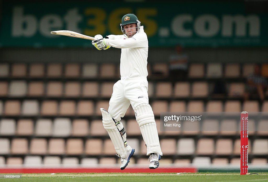 <a gi-track='captionPersonalityLinkClicked' href=/galleries/search?phrase=Phillip+Hughes+-+Cricketer&family=editorial&specificpeople=757530 ng-click='$event.stopPropagation()'>Phillip Hughes</a> of Australia plays a cut shot during day one of the First Test match between Australia and Sri Lanka at Blundstone Arena on December 14, 2012 in Hobart, Australia.
