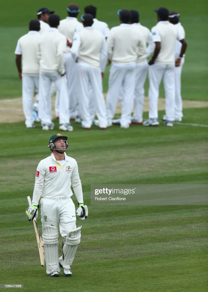 <a gi-track='captionPersonalityLinkClicked' href=/galleries/search?phrase=Phillip+Hughes+-+Cricketer&family=editorial&specificpeople=757530 ng-click='$event.stopPropagation()'>Phillip Hughes</a> of Australia walks from the ground after he was bowled by Chanaka Welegedara of Sri Lanka during day one of the First Test match between Australia and Sri Lanka at Blundstone Arena on December 14, 2012 in Hobart, Australia.
