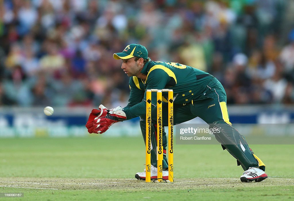 Phillip Hughes of Australia wicketkeeps after Brad Haddin left the ground with an injury during game two of the Commonwealth Bank One Day International series between Australia and Sri Lanka at Adelaide Oval on January 13, 2013 in Adelaide, Australia.
