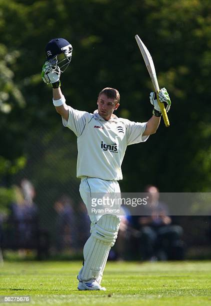 Phillip Hughes of Middlesex and Australia celebrates after reaching his century during day two of the LV County Championship Division Two match...