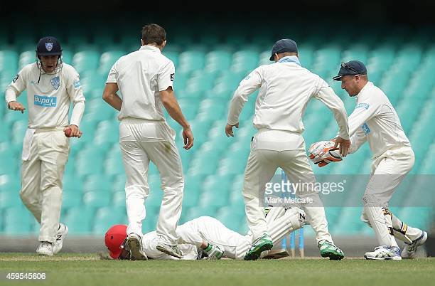 Phillip Hughes of South Australia falls to the ground after being struck in the head by a delivery during day one of the Sheffield Shield match...