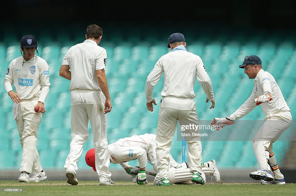 Phillip Hughes of South Australia falls to the ground after being struck in the head by a delivery during day one of the Sheffield Shield match between New South Wales and South Australia at Sydney Cricket Ground on November 25, 2014 in Sydney, Australia.