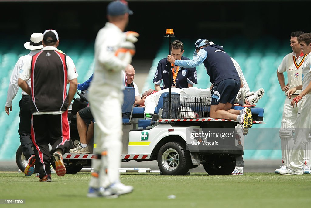 Phillip Hughes of South Australia lays on a stretcher after being struck in the head by a delivery during day one of the Sheffield Shield match between New South Wales and South Australia at Sydney Cricket Ground on November 25, 2014 in Sydney, Australia.