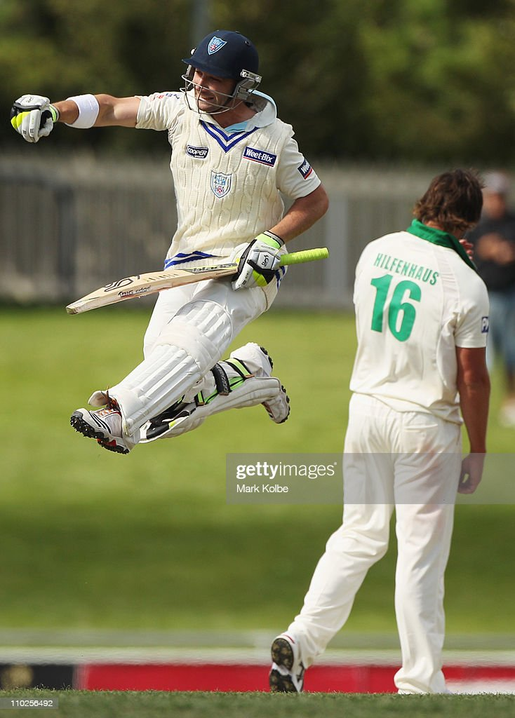 Phillip Hughes of the Blues celebrates his century during day one of the Sheffield Shield final match between the Tasmanian Tigers and the New South Wales Blues at Bellerive Oval on March 17, 2011 in Hobart, Australia.