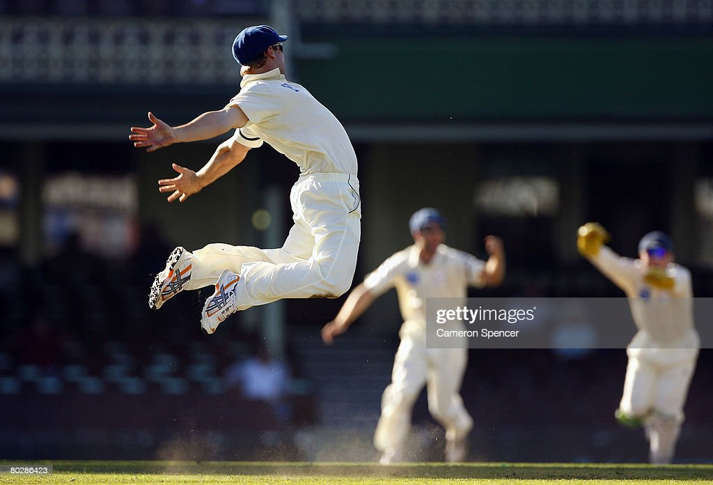 Phillip Hughes of the Blues celebrates taking the catch of Brad Hodge of the Bushrangers off the bowling of Stuart MacGill during day four of the Pura Cup Final match between the New South Wales Blues and the Victorian Bushrangers at the Sydney Cricket Ground on March 18, 2008 in Sydney, Australia.