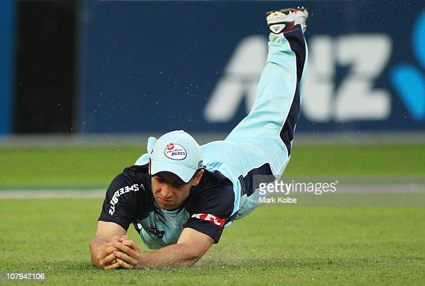 Phillip Hughes of the Blues dives to take a catch during the Twenty20 Big Bash match between the New South Wales Blues and the Western Australia...