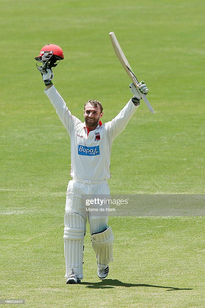 <a gi-track='captionPersonalityLinkClicked' href=/galleries/search?phrase=Phillip+Hughes+-+Cricketer&family=editorial&specificpeople=757530 ng-click='$event.stopPropagation()'>Phillip Hughes</a> of the Redbacks celebrates after reaching 100 runs during day three of the Sheffield Shield match between the Redbacks and the Warriors at Adelaide Oval on November 15, 2013 in Adelaide, Australia.