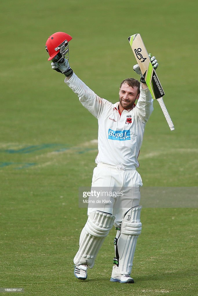 <a gi-track='captionPersonalityLinkClicked' href=/galleries/search?phrase=Phillip+Hughes+-+Cricketspeler&family=editorial&specificpeople=757530 ng-click='$event.stopPropagation()'>Phillip Hughes</a> of the Redbacks celebrates after reaching 200 runs during day three of the Sheffield Shield match between the Redbacks and the Warriors at Adelaide Oval on November 15, 2013 in Adelaide, Australia.