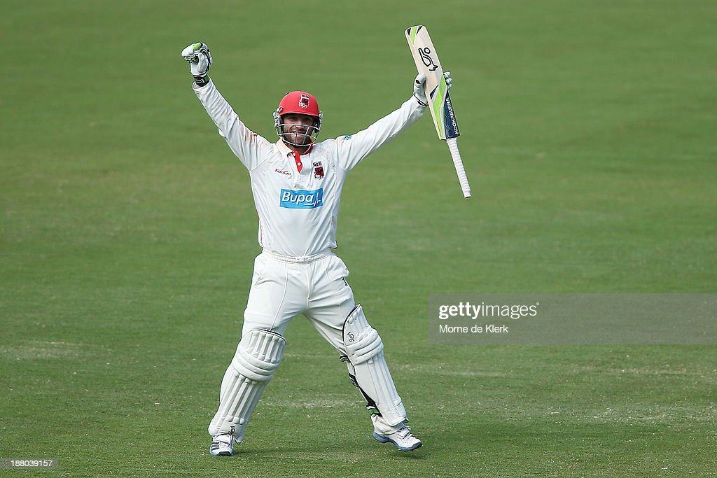 Phillip Hughes of the Redbacks celebrates after reaching 200 runs during day three of the Sheffield Shield match between the Redbacks and the Warriors at Adelaide Oval on November 15, 2013 in Adelaide, Australia.