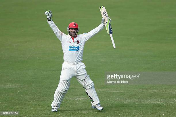 Phillip Hughes of the Redbacks celebrates after reaching 200 runs during day three of the Sheffield Shield match between the Redbacks and the...