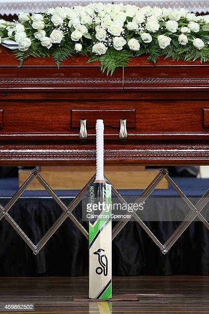 Phillip Hughes's cricket bat rests against his coffin during the Funeral Service for Phillip Hughes at Macksville High School Stadium on December 3...