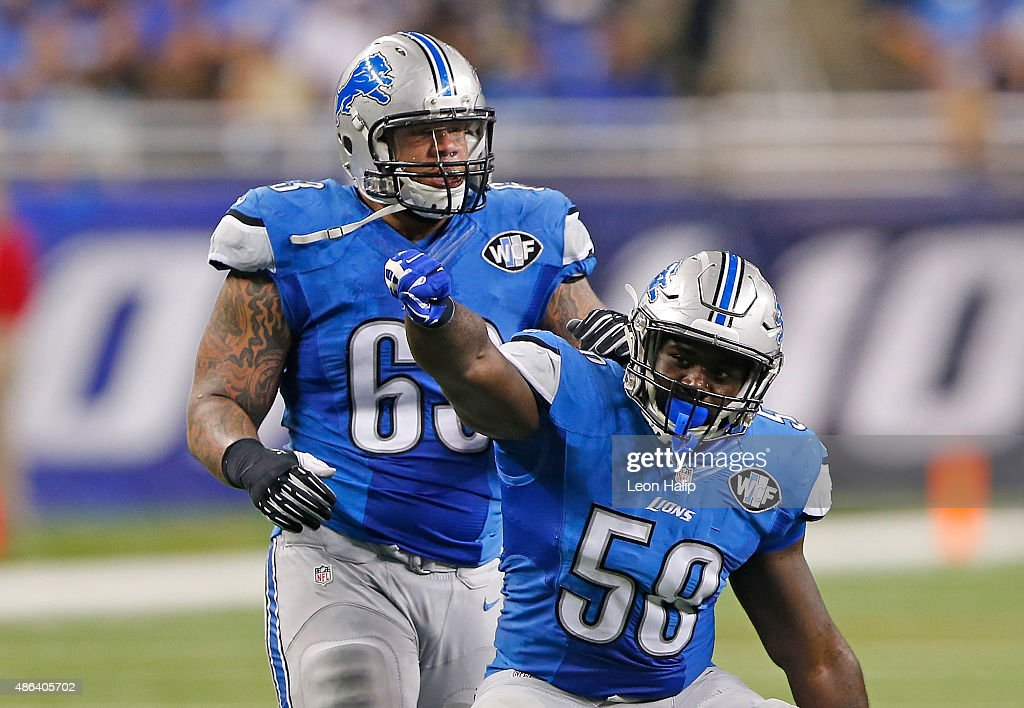 Phillip Hunt #58 of the Detroit Lions celebrates a sack with teammate Jermelle Cudjo #63 on quarterback Matt Simms #8 of the Buffalo Bills (not in photo) during the third quarter of the preseason game on September 3, 2015 at Ford Field Detroit, Michigan.