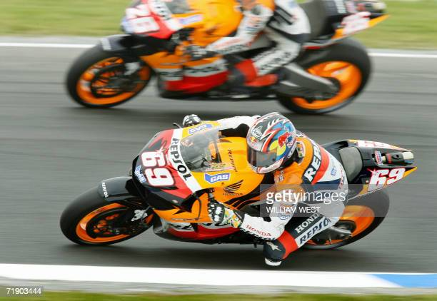 US MotoGP rider Nicky Hayden powers past teammate Dani Pedrosa of Spain during a practice session for the 2006 Australian Motocycle Grand Prix on...