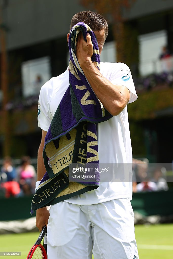 Phillip Kohlschreiber of Germany cools down during the Men's Singles first round match against Pierre-Hugues Herbert of France on day one of the Wimbledon Lawn Tennis Championships at the All England Lawn Tennis and Croquet Club on June 27th, 2016 in London, England.