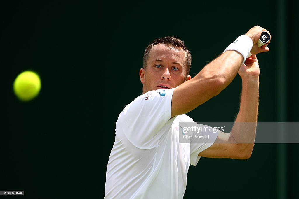 Phillip Kohlschreiber of Germany plays a backhand shot during the Men's Singles first round match against Pierre-Hugues Herbert of France on day one of the Wimbledon Lawn Tennis Championships at the All England Lawn Tennis and Croquet Club on June 27th, 2016 in London, England.