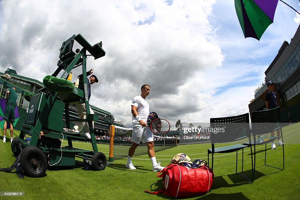 Phillip Kohlschreiber of Germany walks on during the Men's Singles first round match against Pierre-Hugues Herbert of France on day one of the Wimbledon Lawn Tennis Championships at the All England Lawn Tennis and Croquet Club on June 27th, 2016 in London, England.