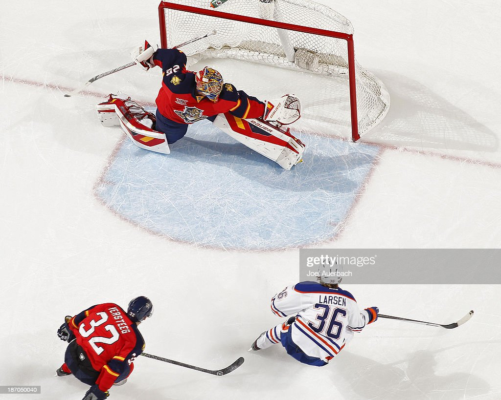 Phillip Larsen #36 of the Edmonton Oilers scores a first period goal past Goaltender <a gi-track='captionPersonalityLinkClicked' href=/galleries/search?phrase=Jacob+Markstrom&family=editorial&specificpeople=5370948 ng-click='$event.stopPropagation()'>Jacob Markstrom</a> #25 of the Florida Panthers at the BB&T Center on November 5, 2013 in Sunrise, Florida. The Oilers defeated the Panthers 4-3 in overtime.