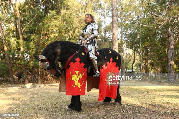 Phillip Leitch of Australia waits on his mounts as he prepares to compete in the World Jousting Championships as part of the St Ives Medieval Faire...