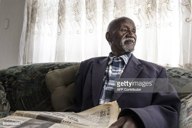 Phillip Mabelane sits with a copy of a 1977 newspaper at his son Lasch Mabelane's home in Diepkloof South Africa on September 29 2017 For 40 years he...