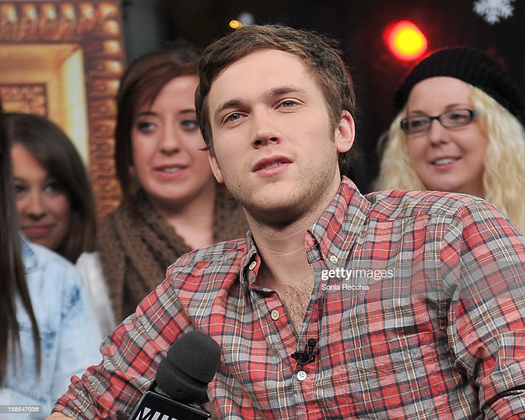 <a gi-track='captionPersonalityLinkClicked' href=/galleries/search?phrase=Phillip+Phillips&family=editorial&specificpeople=1651494 ng-click='$event.stopPropagation()'>Phillip Phillips</a> attends NEW.MUSIC.LIVE. at MuchMusic Headquarters on December 18, 2012 in Toronto, Canada.