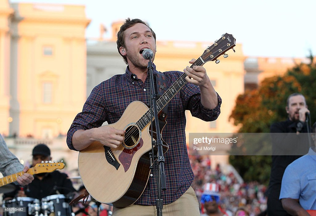 <a gi-track='captionPersonalityLinkClicked' href=/galleries/search?phrase=Phillip+Phillips&family=editorial&specificpeople=1651494 ng-click='$event.stopPropagation()'>Phillip Phillips</a> performs at PBS's 2014 A CAPITOL FOURTH at U.S. Capitol, West Lawn on July 4, 2014 in Washington, DC.