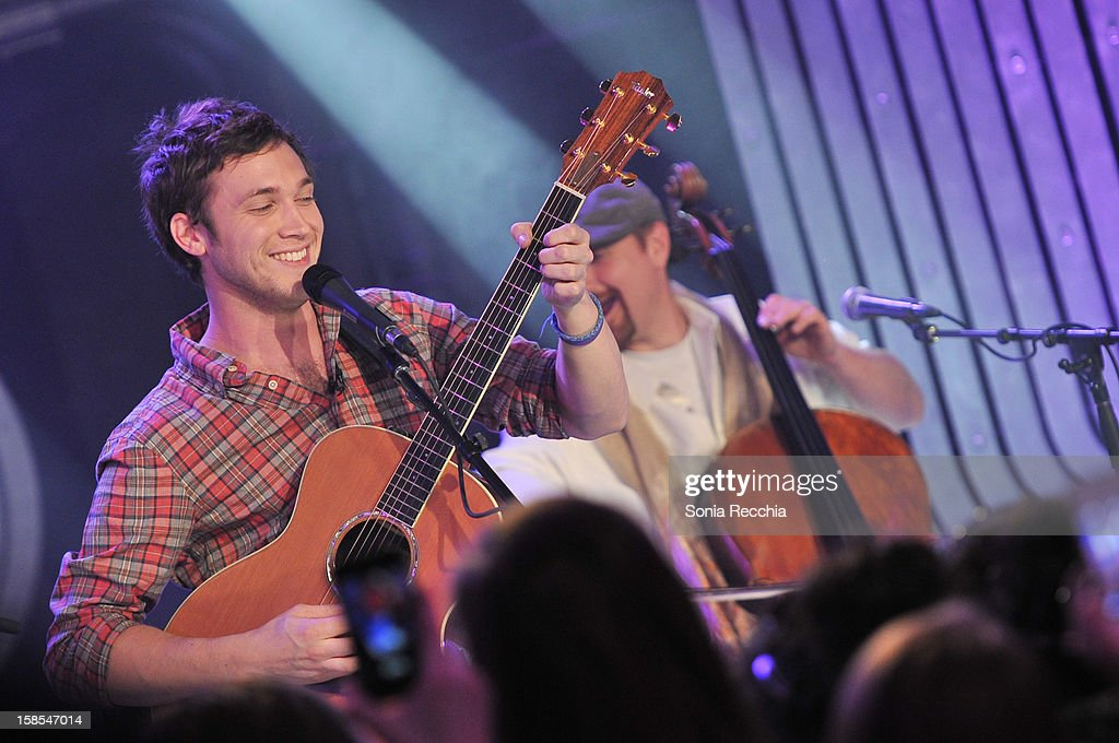 <a gi-track='captionPersonalityLinkClicked' href=/galleries/search?phrase=Phillip+Phillips&family=editorial&specificpeople=1651494 ng-click='$event.stopPropagation()'>Phillip Phillips</a> performs on NEW.MUSIC.LIVE. at MuchMusic Headquarters on December 18, 2012 in Toronto, Canada.