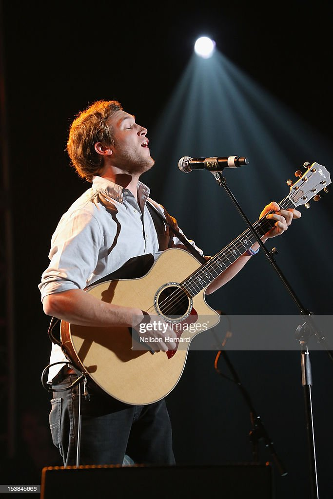Phillip Phillips performs onstage at the One World Concert at Syracuse University on October 9 2012 in Syracuse New York