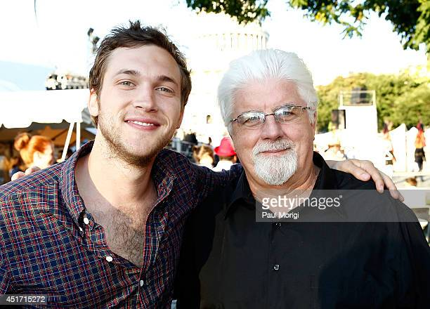 Phillip Phillips poses for a photo with Michael McDonald backstage at PBS's 2014 A CAPITOL FOURTH at US Capitol West Lawn on July 4 2014 in...