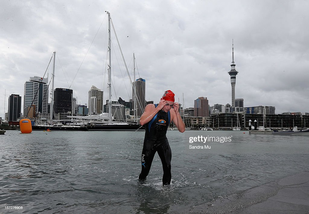 Phillip Ryan emerges from the water during the Auckland Harbour Crossing ocean swim event at the Viaduct Harbour on December 2, 2012 in Auckland, New Zealand.