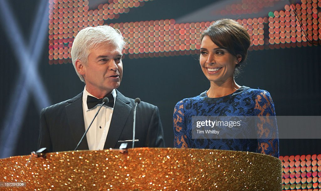 <a gi-track='captionPersonalityLinkClicked' href=/galleries/search?phrase=Phillip+Schofield&family=editorial&specificpeople=629203 ng-click='$event.stopPropagation()'>Phillip Schofield</a> and <a gi-track='captionPersonalityLinkClicked' href=/galleries/search?phrase=Christine+Bleakley&family=editorial&specificpeople=5831033 ng-click='$event.stopPropagation()'>Christine Bleakley</a> present the British Olympic Ball at the Grosvenor Hotel on November 30, 2012 in London, England.