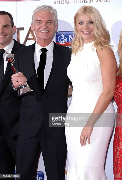 Phillip Schofield and Holly Willoughby of 'This Morning' accept the award for Best Live Magazine at the 21st National Television Awards at The O2...