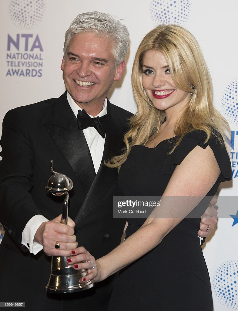 Phillip Schofield and Holly Willoughby, winners of Daytime award poses in the Winners room at the National Television Awards at 02 Arena on January 23, 2013 in London, England.