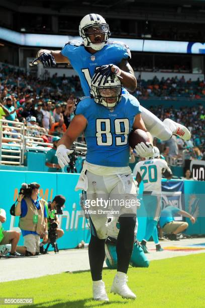Phillip Supernaw celebrates with Rishard Matthews of the Tennessee Titans after completing a touchdown reception in the third quarter against the...
