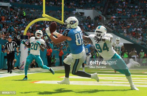 Phillip Supernaw of the Tennessee Titans completes a touchdown reception in the third quarter against Lawrence Timmons of the Miami Dolphins on...