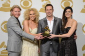 Phillip Sweet Kimberly Schlapman Jimi Westbrook and Karen Fairchild of Little Big Town pose in the press room during the 55th Annual GRAMMY Awards at...