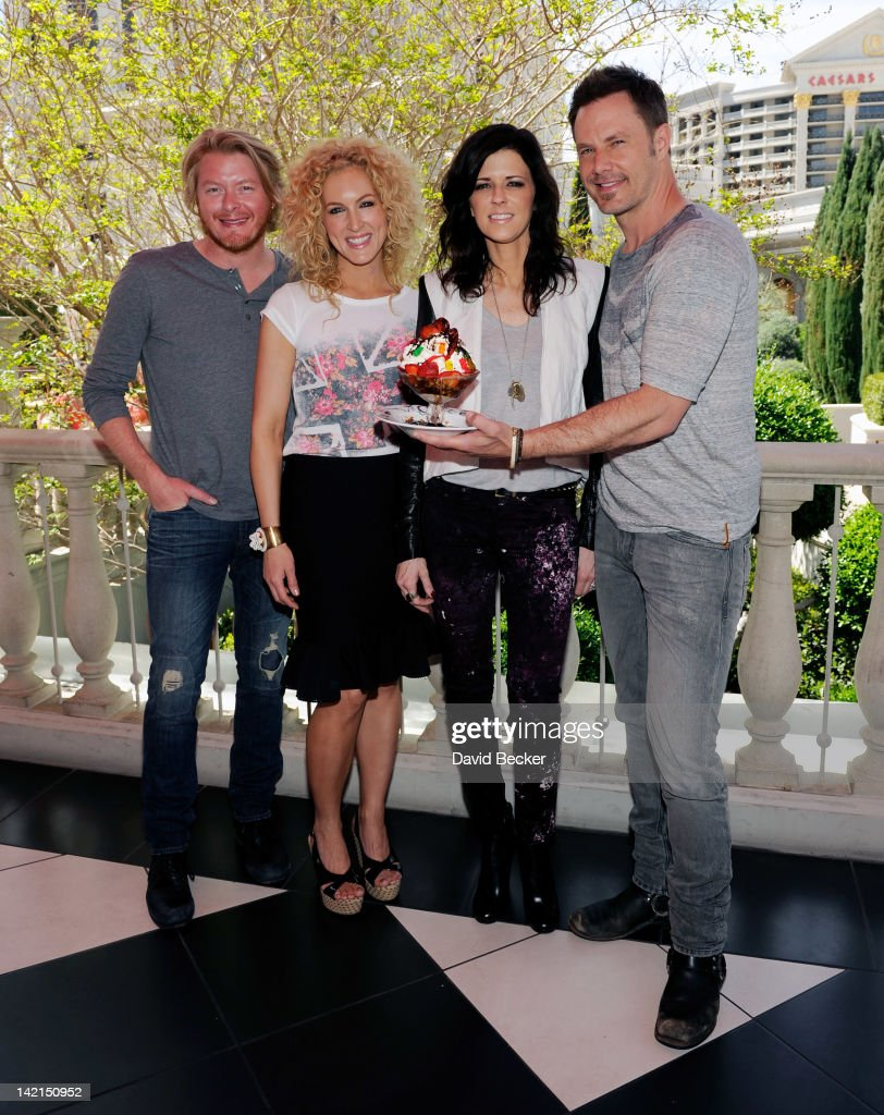 Phillip Sweet, Kimberly Schlapman, Karen Fairchild and Jimi Westbrook of Little Big Town appear with a sundae named in their honor at Serendipity 3 at Caesars Palace on March 30, 2012 in Las Vegas, Nevada.