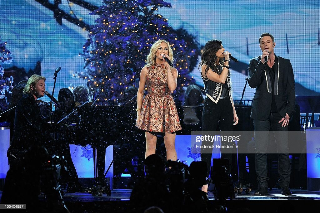 Phillip Sweet, Kimberly Schlapman, Karen Fairchild, and Jimi Westbrook of Little Big Town perform during the 2012 Country Christmas at the Bridgestone Arena on November 3, 2012 in Nashville, United States.