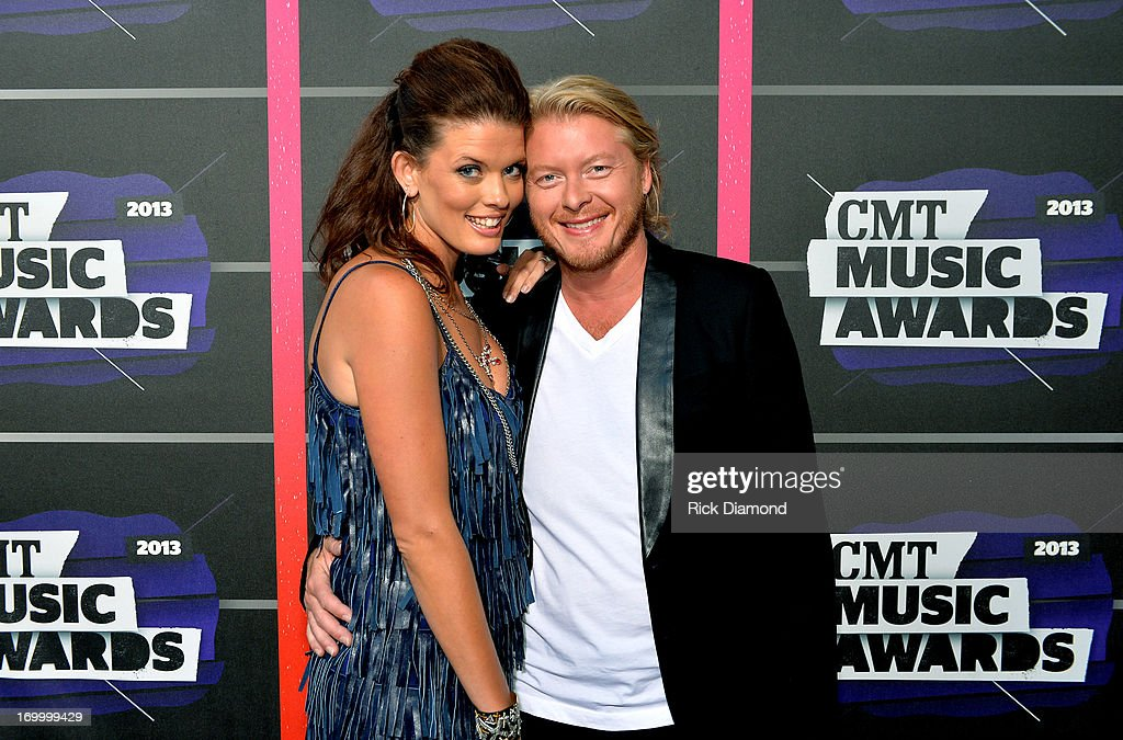 Phillip Sweet (R) of Little Big Town and Rebecca Arthur attend the 2013 CMT Music awards at the Bridgestone Arena on June 5, 2013 in Nashville, Tennessee.