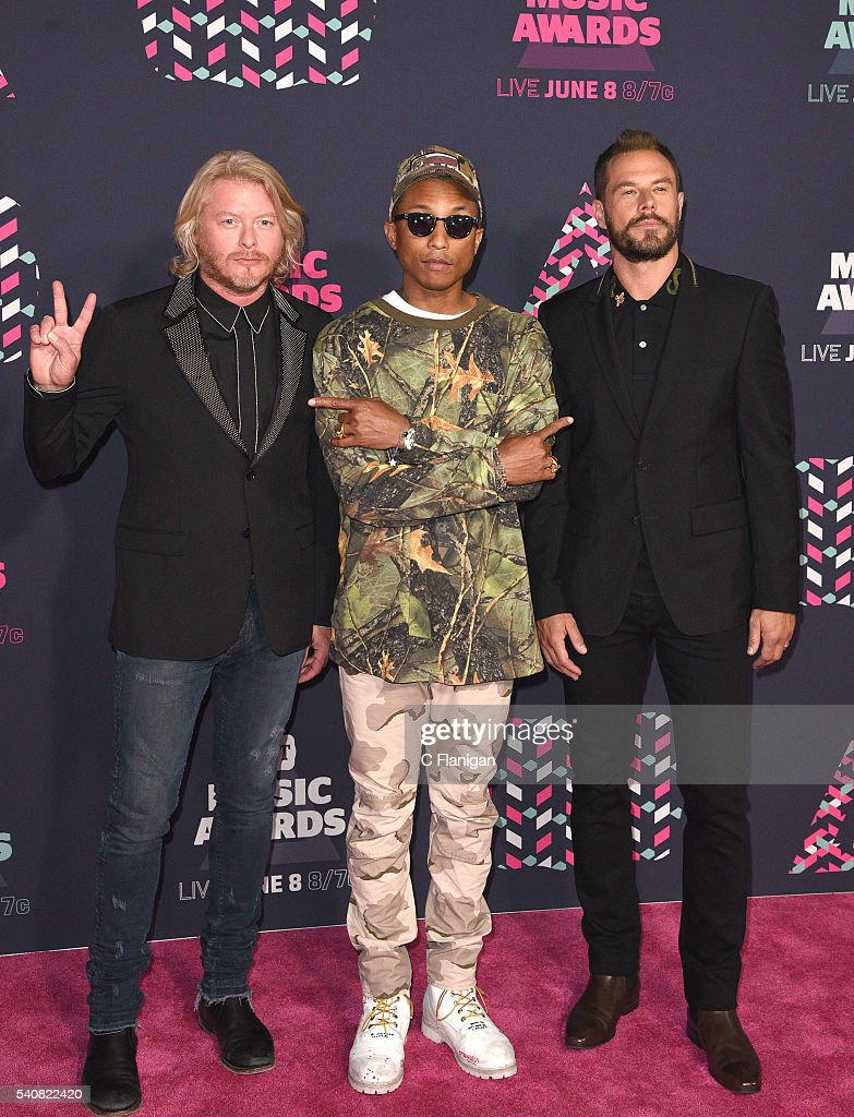 Phillip Sweet of Little Big Town Pharrell Williams and Jimi Westbrook of Little Big Town attend the 2016 CMT Music awards at the Bridgestone Arena on...
