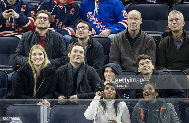 Phillipa Coan Jude Law Iris Law and Rudy Law are seen at Madison Square Garden on December 18 2016 in New York City