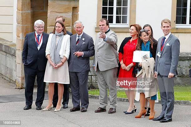 Phillipp Fuerst zu HohenloheLangenburg talks to Prince Charles Prince of Wales during the visit of Schloss Langenburg on May 27 2013 in Langenburg...