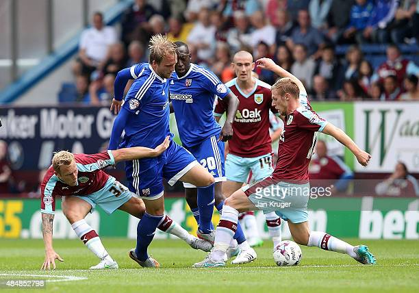 Phillipp Hofmann of Brentford battles with Scott Arfield and Rouwen Hennings of Burnley during the Sky Bet Championship match between Burnley and...