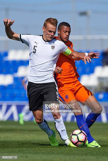 Phillipp Lienhart of Austria competes for the ball with Richairo Zivcovic of Netherlands during the international friendly match between Austria U21...