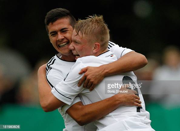Phillipp Ochs of Germany celebrates his team's first goal with teammate Ufuk Akyol during the U16 International Friendly match between Germany and...
