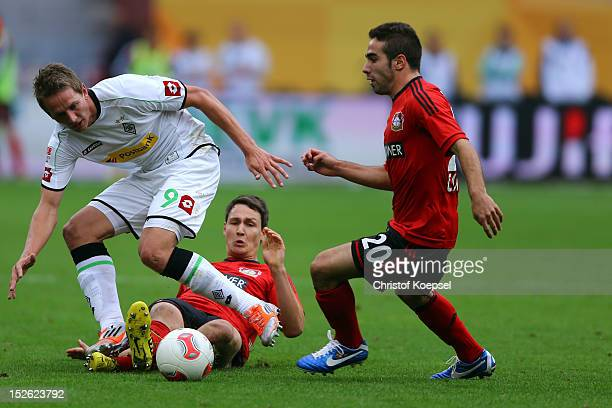 Phillipp Wollscheid and Ramos Carjaval of Leverkusen challenge Luuk de Jong of Moenchengladbach during the Bundesliga match between Bayer 04...
