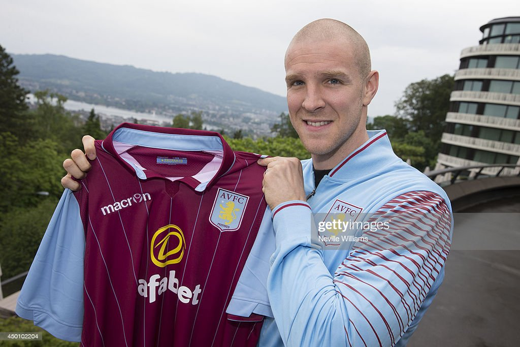 Phillippe Senderos of Aston Villa poses for a picture after agreeing a deal to sign for Aston Villa at the Dolder Hotel in Zurich on June 04, 2014 in Zurich, Switzerland.